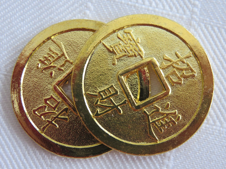 Two gold I Ching coins
