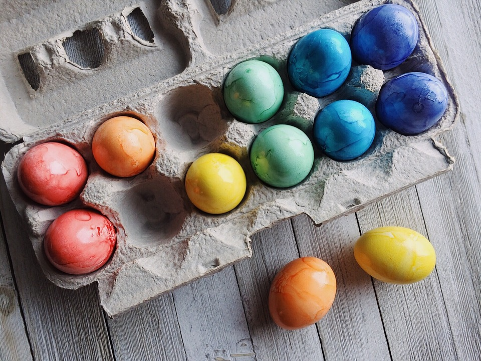 colored easter eggs in a carton
