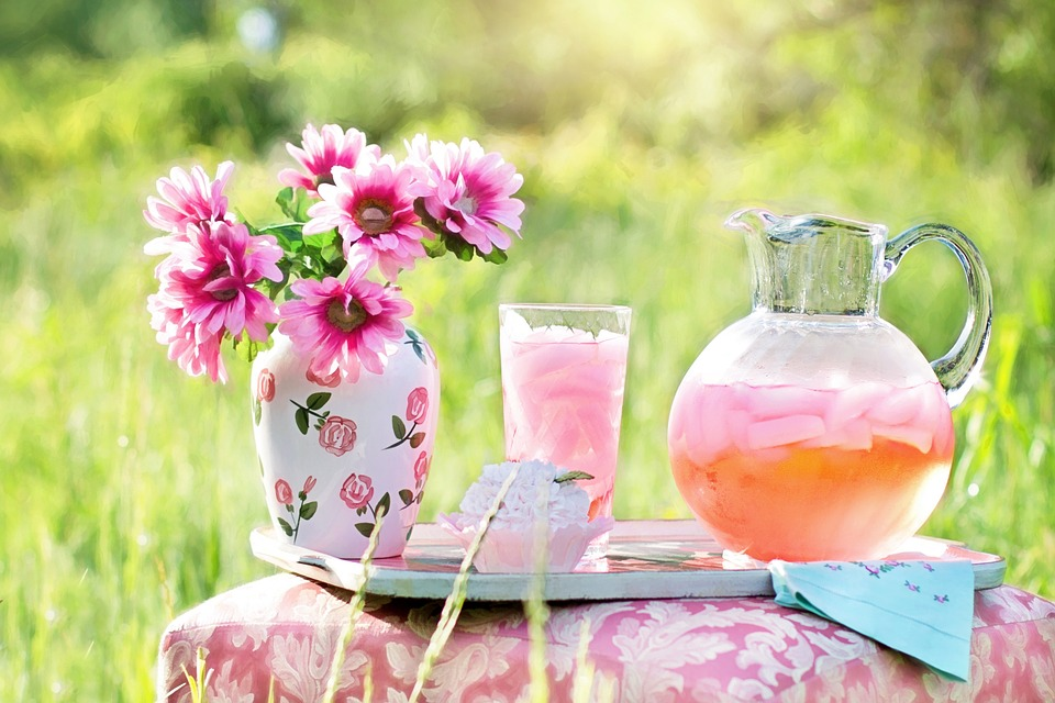 pink flowers and pink lemonade on pink tablecloth